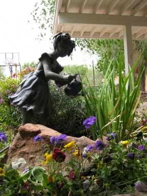 Girl Watering Plants Statue